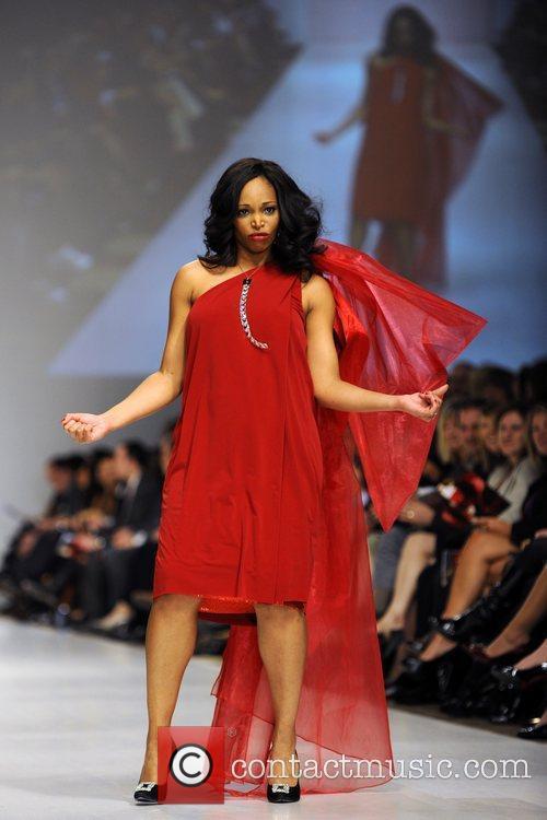 Tracy Moore wears a dress by Joeffer Caoc...