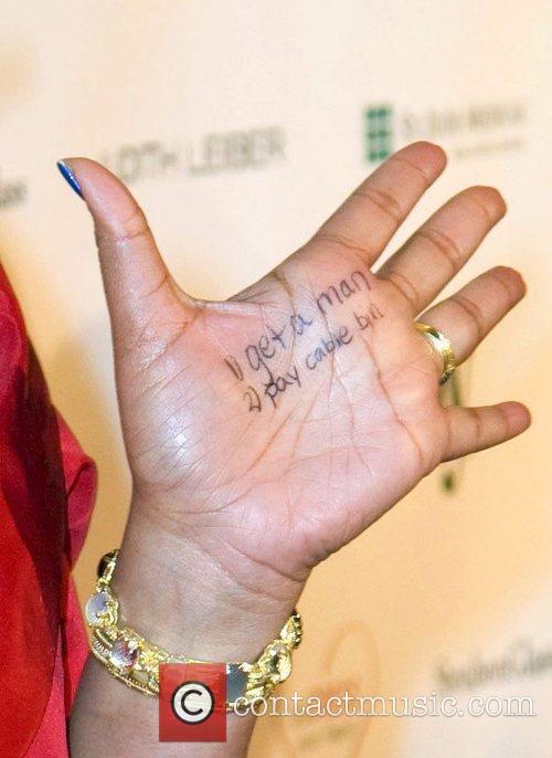 Sherri Shepherd has writing on her hand reading...