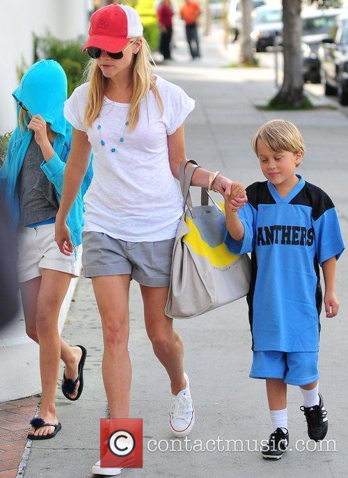 Reese Witherspoon with her boyfriend and daughter Ava...