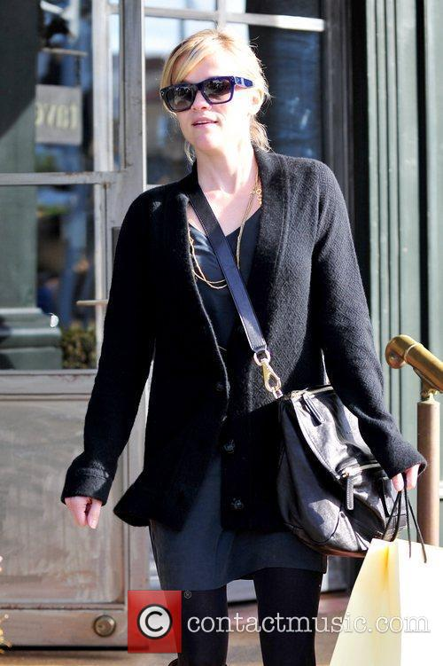 Reese Witherspoon newly engaged star leaving a restaurant...