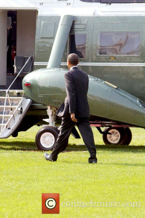 President Barack Obama walking across the South Lawn...