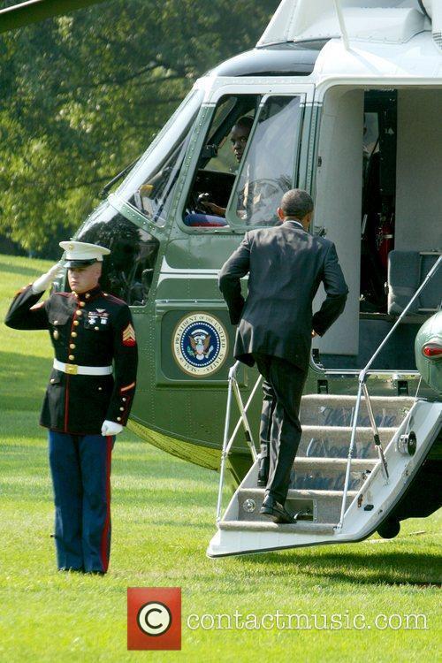 President Barack Obama boarding Marine One, after attending...