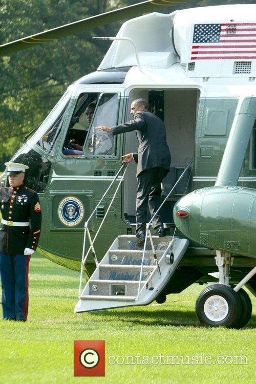 Boarding Marine One, after attending a reception for...