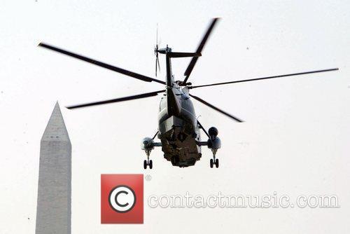 President Barack Obama on Marine One, after attending...