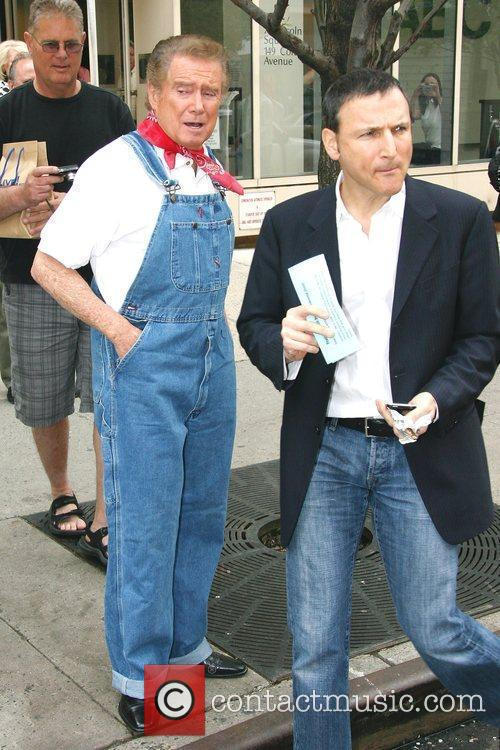 Regis Philbin, wearing denim overalls, leaving ABC studios...