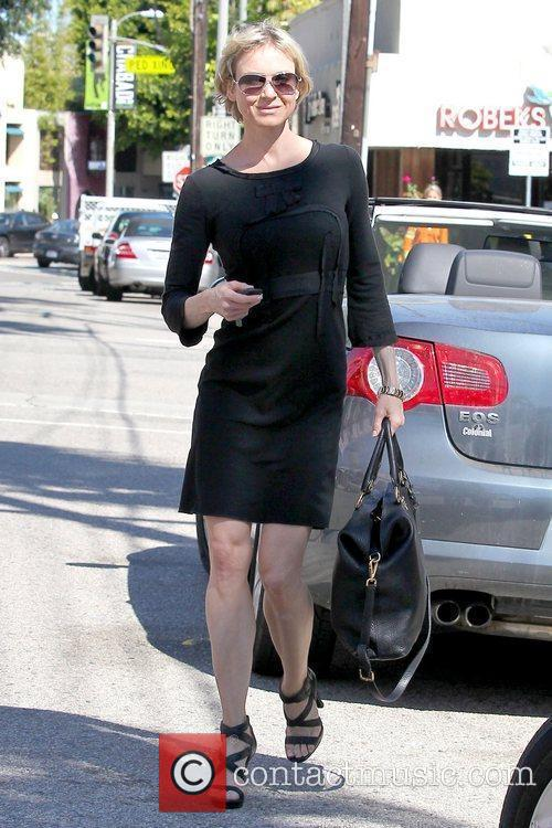Returning to her car after shopping in Brentwood