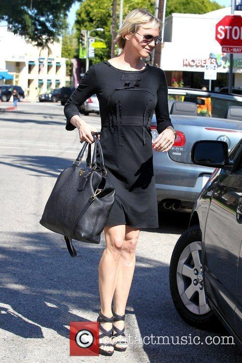 Renee Zellweger returning to her car after shopping...
