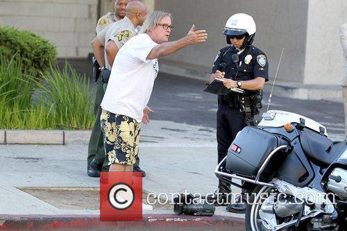 Receiving a ticket for jaywalking outside Beverly Hills...