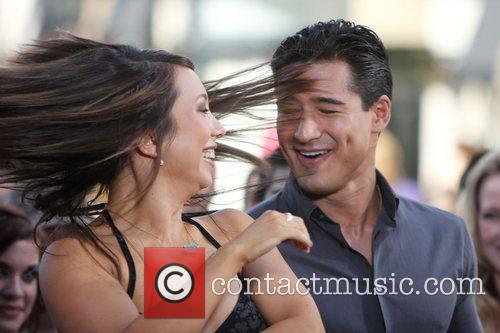 Cheryl Burke filming an interview with Mario Lopez...