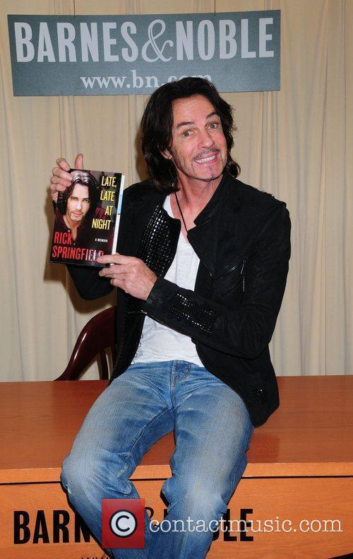 Musician Rick Springfield signs copies of his book...