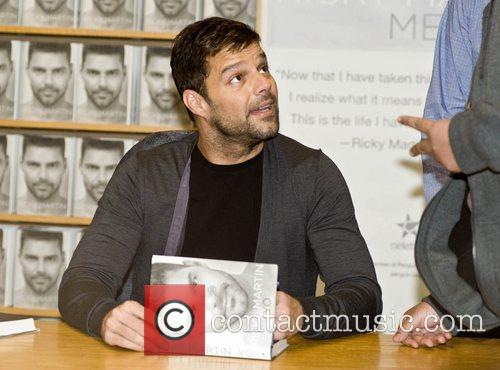 Signs copies of his autobiography 'Me' at Borders...