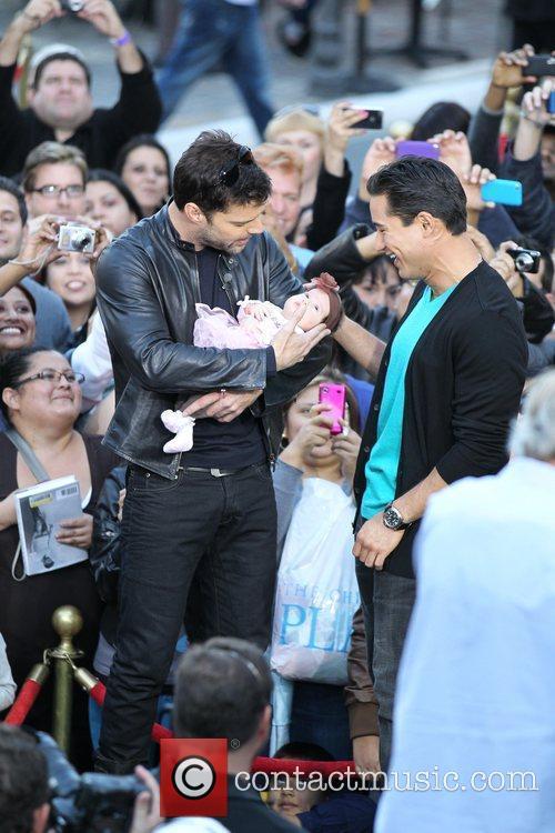 Ricky Martin holds Gia Francesca Lopez with Mario...