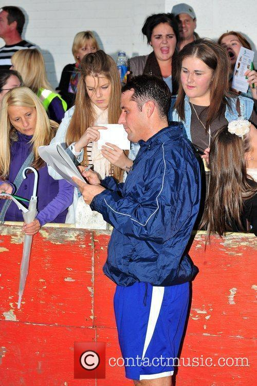Hollyoaks star Nick Pickard signs autographs at a...
