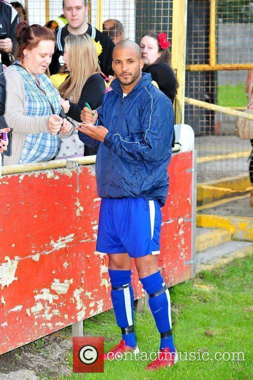 Ex-Hollyoaks star Ricky Whittle signs autographs for fans...