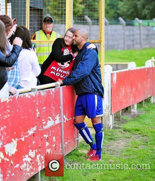 Ex-Hollyoaks star Ricky Whittle poses for photographs with...