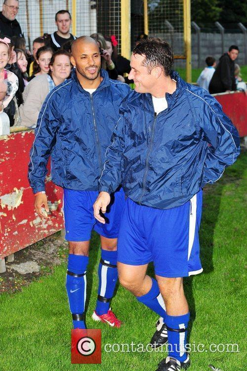 Ricky Whittle and Nick Pickard play in a...