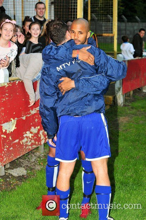 Ricky Whittle and Nick Pickard embrace in hug...