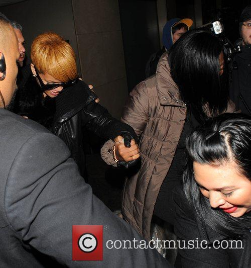Rihanna leaves Whisky Mist club holding a friends...