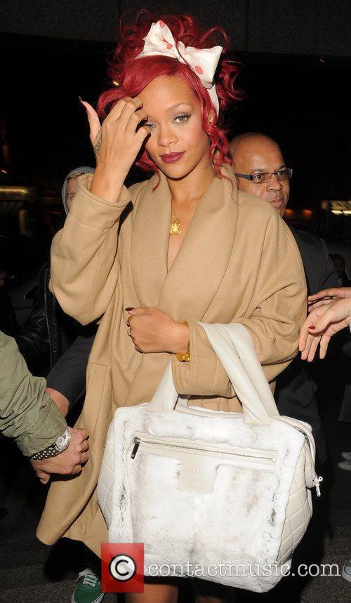 Rihanna arrives back at her hotel, having turned...