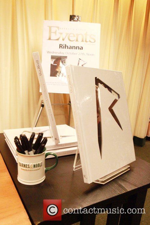 Rihanna signs copies of 'Rihanna: Rihanna' at Barnes...