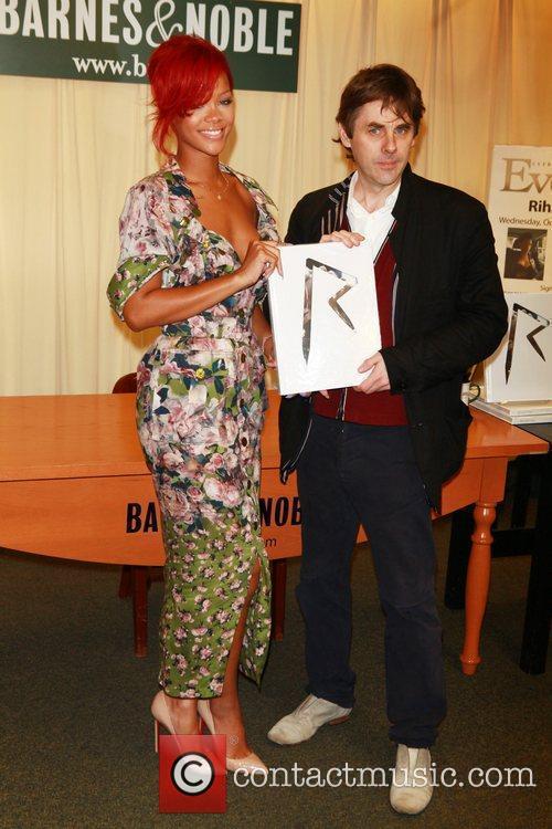 Rihanna and Simon Henwood Rihanna signs copies of...