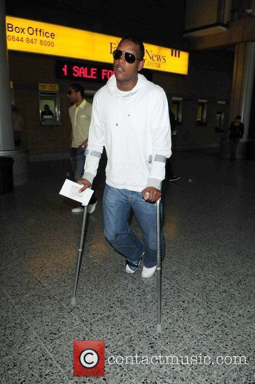 Titus Bramble on crutches  arriving at the...