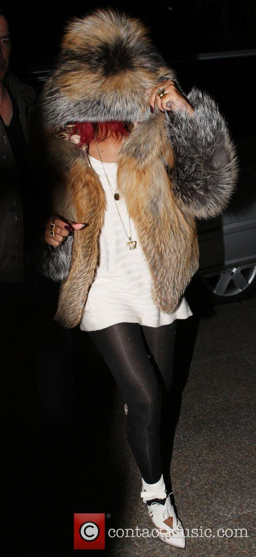 Rihanna arrives at Whisky Mist wearing an oversized...