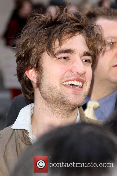 Robert Pattinson meeting fans in the crowd at...