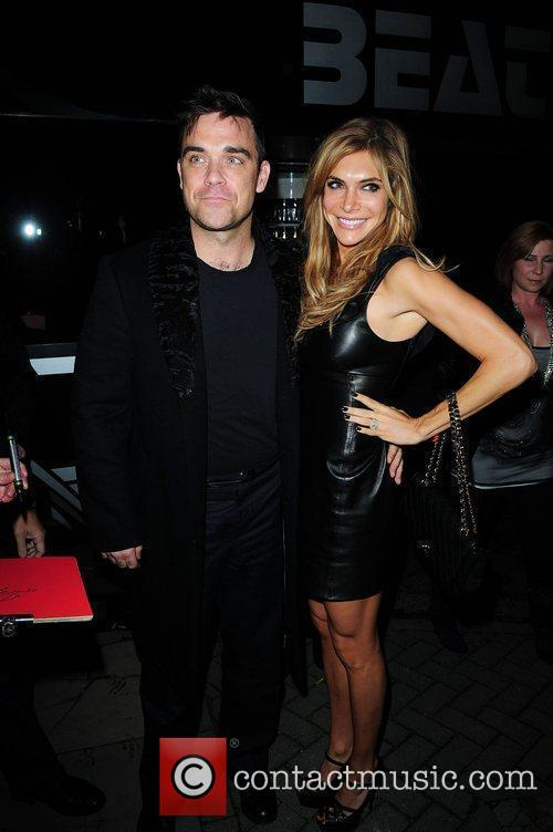 Robbie Williams and wife Ayda Field arrive at...