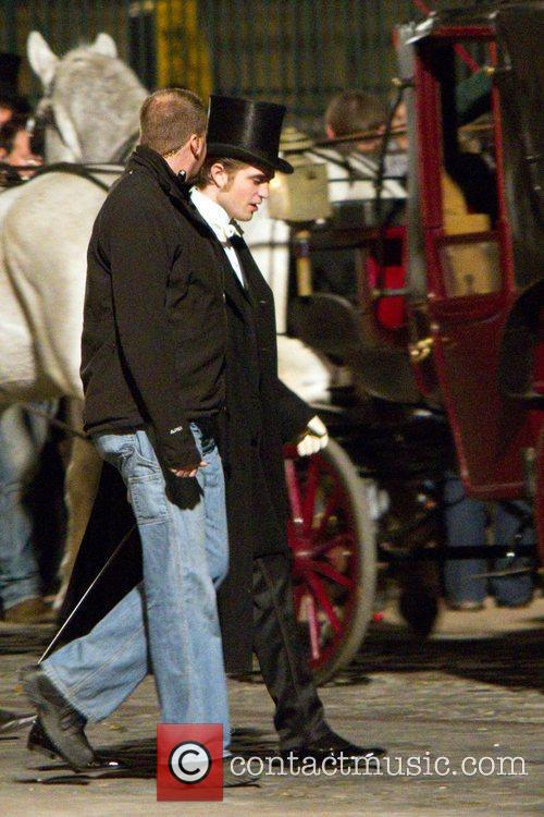 Robert Pattinson dressed in period clothing while filming...