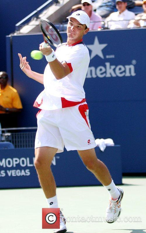 Roger Federer ( SUI) competes against Andreas Beck...