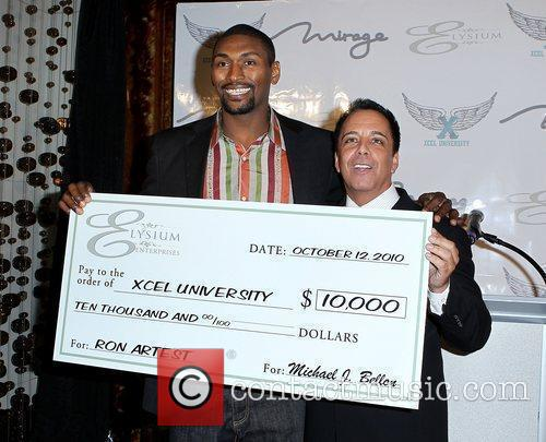 Ron Artest receives a cheque from Michael Bellon...
