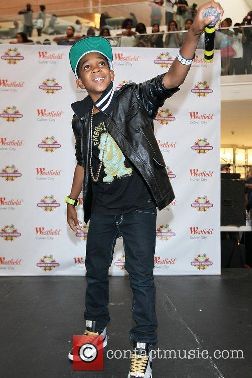 Myles Brown performing at the Grand opening of...