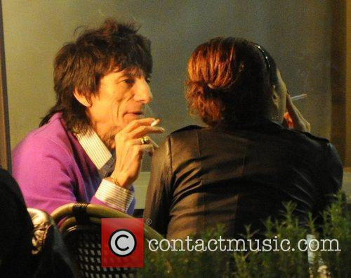 Ronnie Wood, his girlfriend Ana Araujo pop outside for a cigarette break and during a meal together at a restaurant in Mayfair. 11