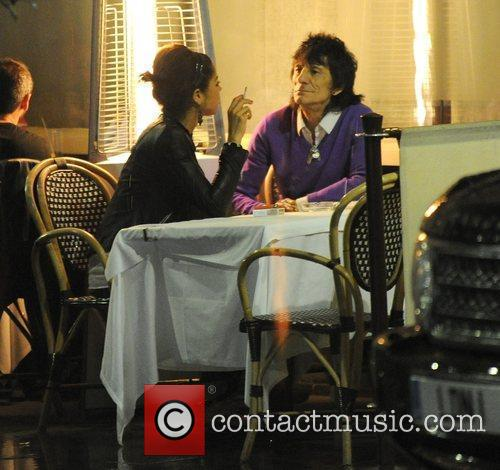 Ronnie Wood, his girlfriend Ana Araujo pop outside for a cigarette break and during a meal together at a restaurant in Mayfair. 9