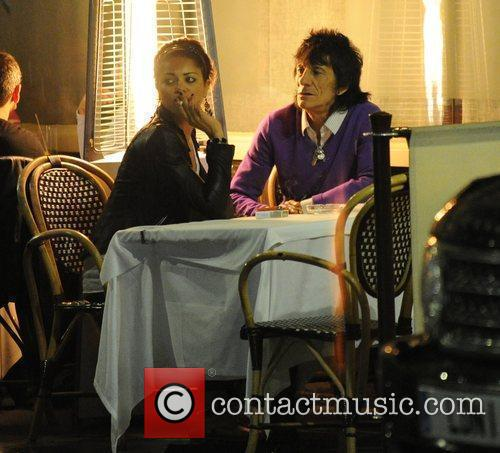 Ronnie Wood, his girlfriend Ana Araujo pop outside for a cigarette break and during a meal together at a restaurant in Mayfair. 10
