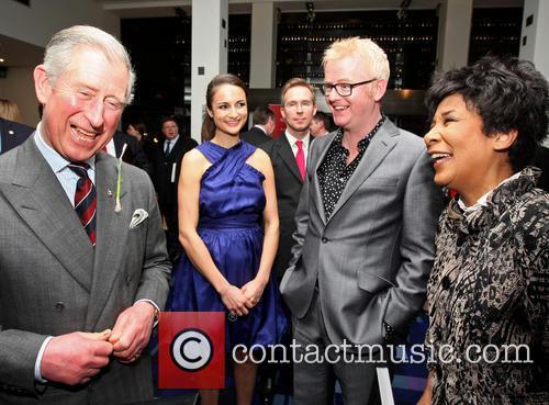 Prince Charles, Prince of Wales meets Natasha Evans,...