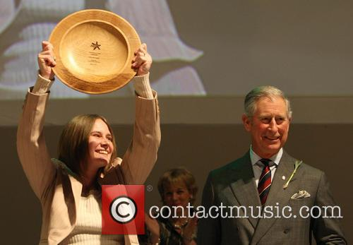 Prince Charles, Prince of Wales presents Karen McLaughlin...