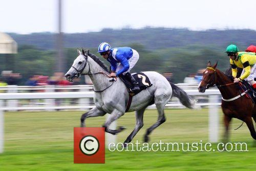 Aejal and Richard Hills lead the field in...