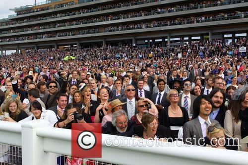 Racegoers watching cheering home the winners Royal Ascot...