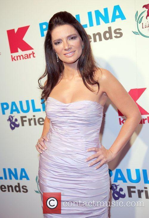 Attends the Paulina Rubio and Friends concert to...