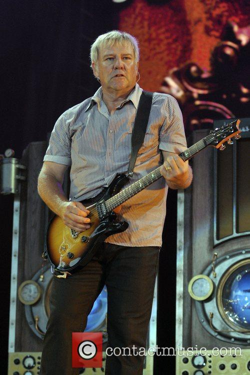 Alex Lifeson of RUSH performing live on stage...