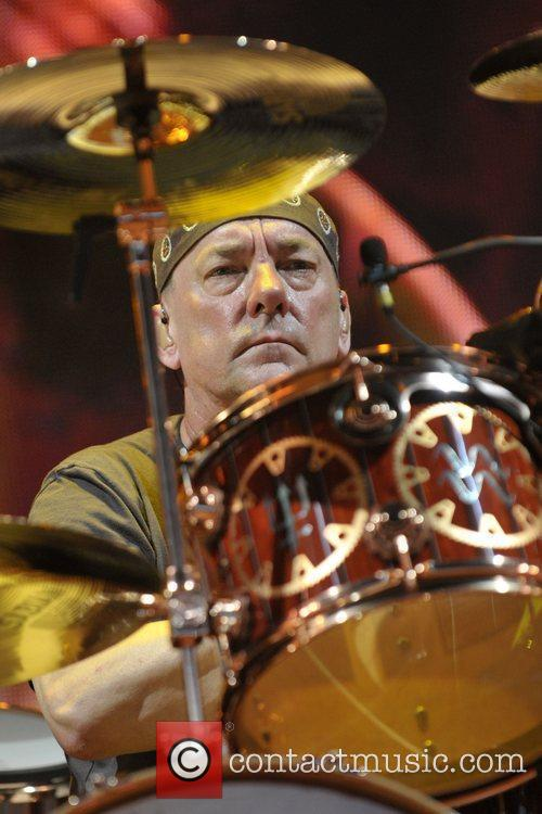 Neil Peart of RUSH performing live on stage...