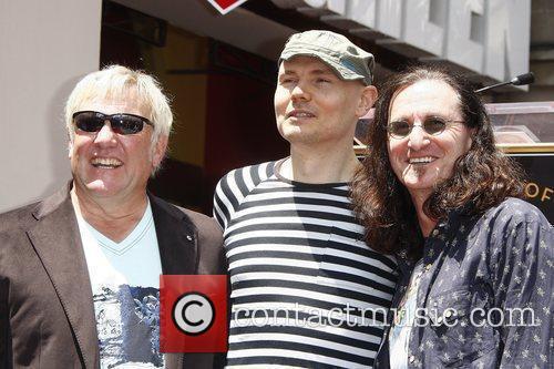 Alex Lifeson, Billy Corgan, Geddy Lee Rush is...