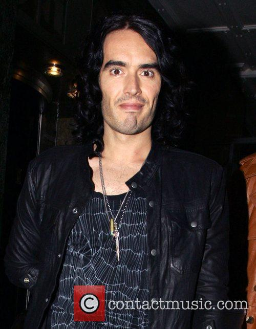 Russell Brand leaves his hotel wearing a gold...