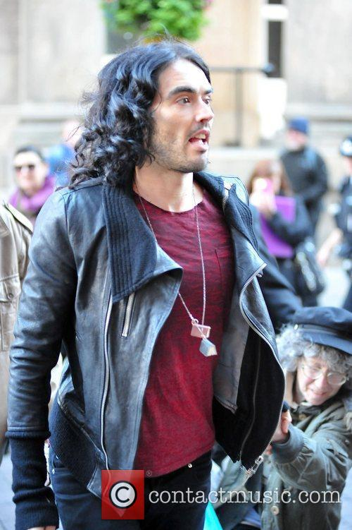 Russell Brand greets fans as he arrives at...
