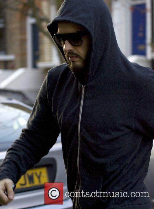 Wearing his West Ham United football kit, returning...