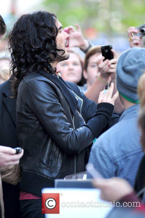 Russell Brand motioning to the large crowd Russell...