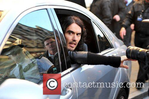 Russell Brand in a car outside Waterstones, where...