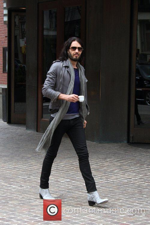 Carries an espresso as he departs his hotel